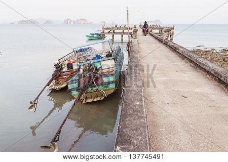 Ko Yao Noi , Phang Nga , Thailand - April 23, 2016: Old concrete pier at at Ko Yao Noi where good destination for many tourists who love peace and nature