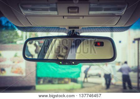 Big rearview mirror inside the luxury car