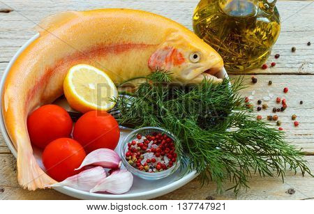 Amber Trout. Fish For Baking With Vegetables And Spices - Tomatoes, Garlic, Lemon, Dill, Sea Salt, P