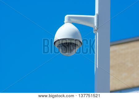 security camera post outside on blue sky