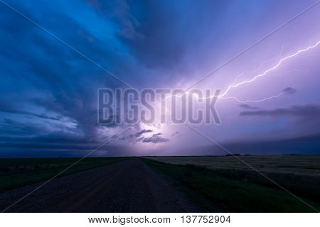 Lightning across the sky above a road in the prairies