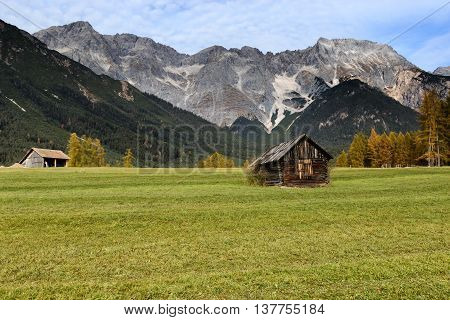 Old wooden hut in mountain at rural fall landscape. Mieminger Plateau Austria Europe.