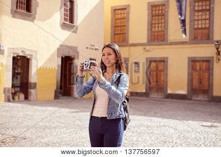 Pretty Young Girl Taking Touristy Pictures