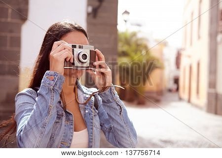 Young Brunette Focusing Her Old Camera