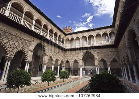 SEVILLE, SPAIN - September 12, 2015: Patio de las Doncellas (Courtyard of the Maidens) with its Mudejar main floor and Renaissance upper gallery Alcazar of Seville on September 12, 2015 in Seville, Spain