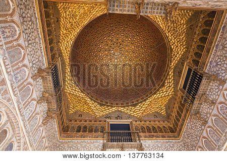 SEVILLE, SPAIN - September 12, 2015: The golden dome of the Salon de los Embajadores (Hall of Ambassadors) Alcazar of Seville on September 12, 2015 in Seville, Spain