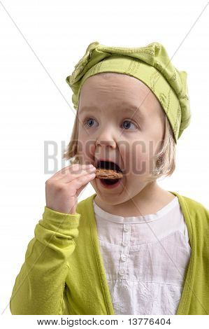 Hungry Little Girl Eating A Cookie