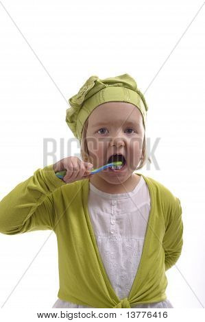 Little Girl Washing Her Teeth