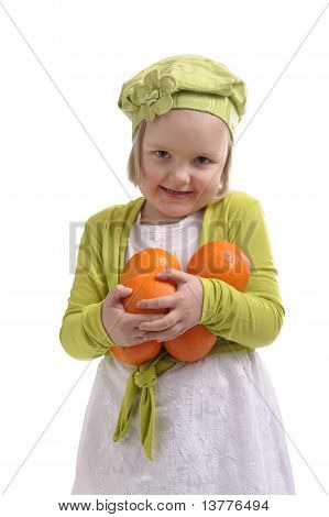 Little Girl Carrying Lots Of Oranges