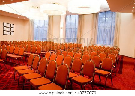 Image of conference hall with empty seats