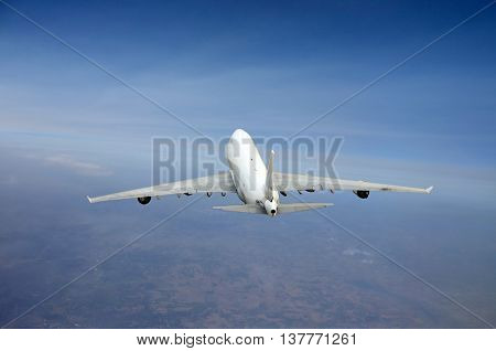 Heavy jumbo jet in flight seen from above