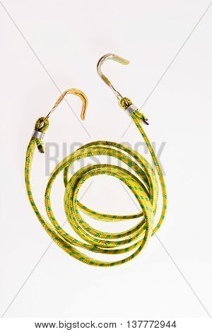 long rubber band for holding cargo on white background