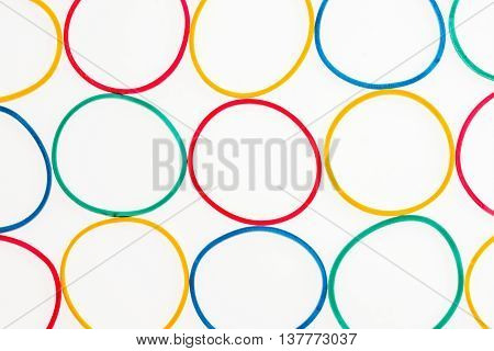 rubber bands of different colors on white geometrical background