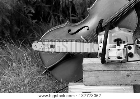 A cello next to a chainsaw music background in black and white