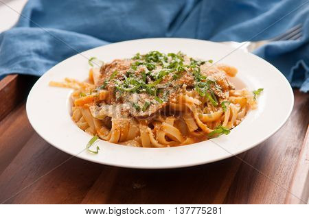 tomato and mushroom whole wheat pasta with cilantro