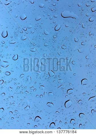 The Raindrops on glass in rainy day.