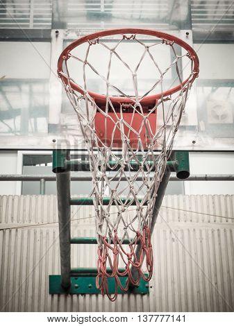 Basketball Hoop in Sport Hall, Retro color filter