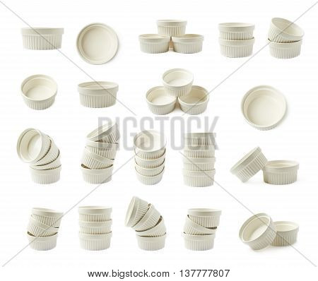White porcelain souffle ramekin dishes composition isolated over the white background, set of multiple different foreshortenings