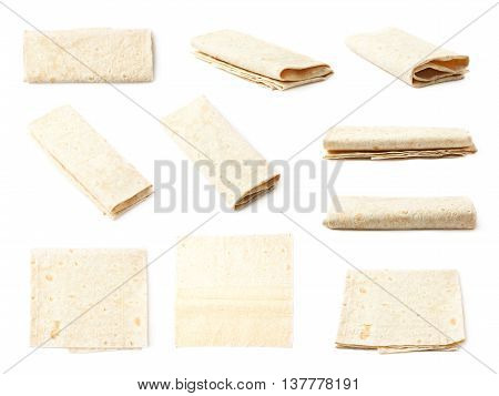 Thin armenian lavash wrap bread isolated over the white background, set of multiple different foreshortenings