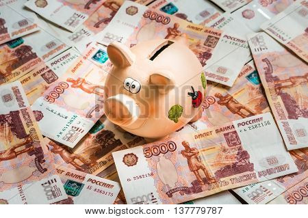 Piggy Bank In A Pile Of Russian Five Thousand Banknotes