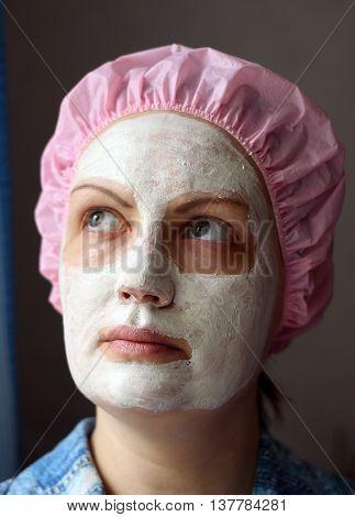 Facial. Face mask skin care Beautiful girl Beauty