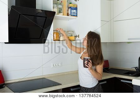 Beautiful Woman In Her Kitchen