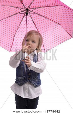 Little Girl Under A Pink  With Dots Umbrella