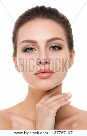 Portrait of young beautiful caucasian woman touching her face isolated over white background. Cleaning face perfect skin. SPA therapy skincare cosmetology and plastic surgery concept
