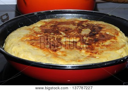 Homemade Spanish tortilla in a traditional tortilla pan Andalusia Spain Western Europe.