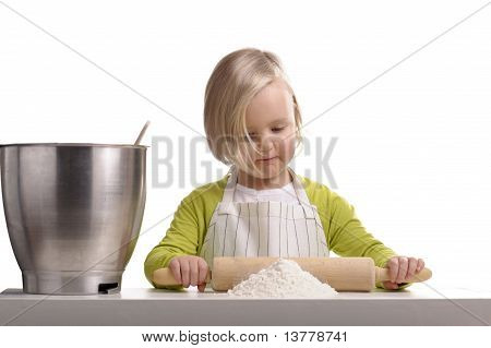 Little Girl Preparing A Cake