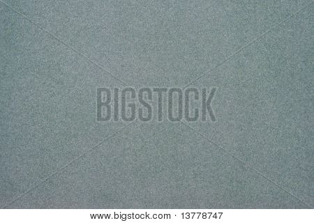 Texture of dense cardboard with grey velvety coating