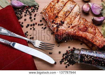 Beef Steaks With Spices On A Wooden Tray
