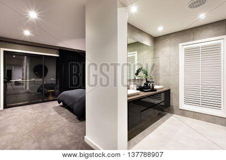 Modern Washroom With A Window And Hallway