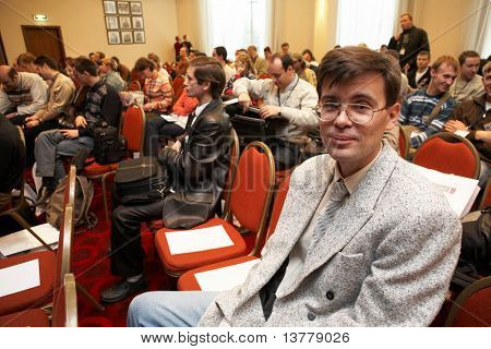 """MOSCOW - OCTOBER 2: Conference """"Stock in Russia 09"""" on October 2, 2009 in Holiday Inn Lesnaya, Moscow, Russia. Listeners sitting on chairs"""