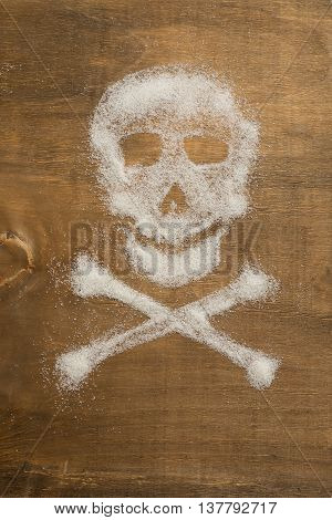 Sugar skull. Unhealthy concept on wooden background