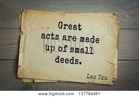 Ancient chinese philosopher Lao Tzu quote on old paper background. Great acts are made up of small deeds.