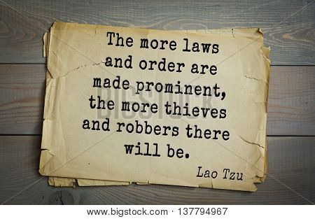Ancient chinese philosopher Lao Tzu quote on old paper background. The more laws and order are made prominent, the more thieves and robbers there will be.