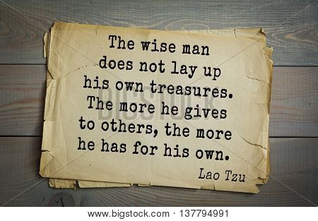 Ancient chinese philosopher Lao Tzu quote on old paper background. The wise man does not lay up his own treasures. The more he gives to others, the more he has for his own.