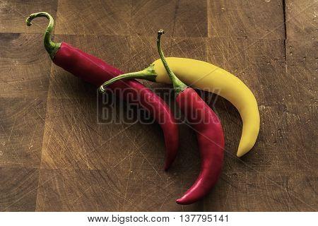 Three spicy chili on a cutting board