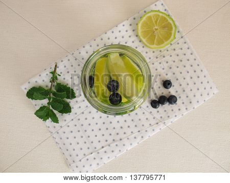 Detox water with lemon, blueberries and mint leaves in jar