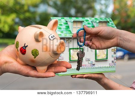 Real Estate Agent Giving House Keys To A New Property Owner, Who