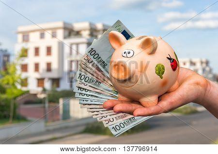 Piggy Bank And Euro Money In Buyer's Hand