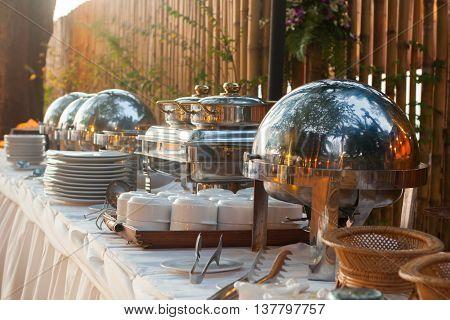 Many buffet heated trays ready for service