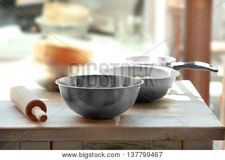 Kitchenware on light wooden table
