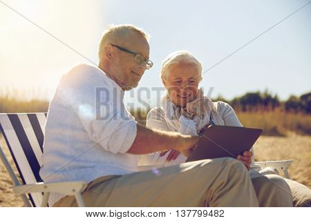 family, age, travel, tourism and people concept - happy senior couple with tablet pc computer restin