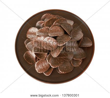 Chocolate chips in brown plate on white background