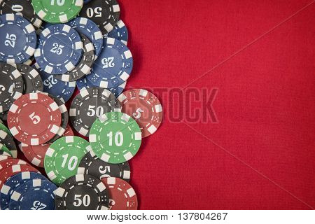 Gambling chips frame on red card table background