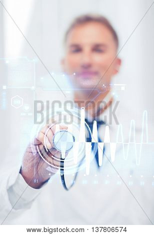 healthcare and medicine concept - male doctor with stethoscope and cardiogram