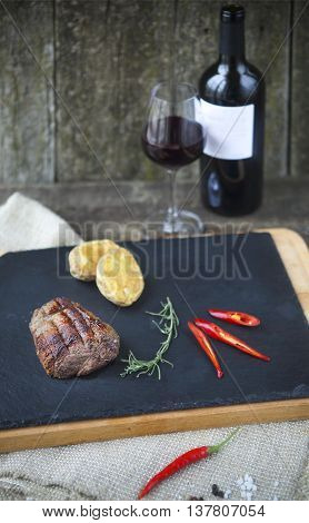 BBQ steak. Barbecue grilled beef steak meat with red wine. Healthy food. Barbeque steak dinner
