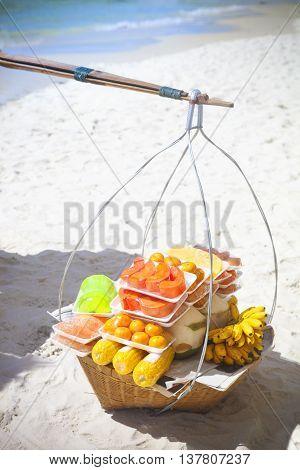 Thai fastfood on the beach. Fruits on the beach